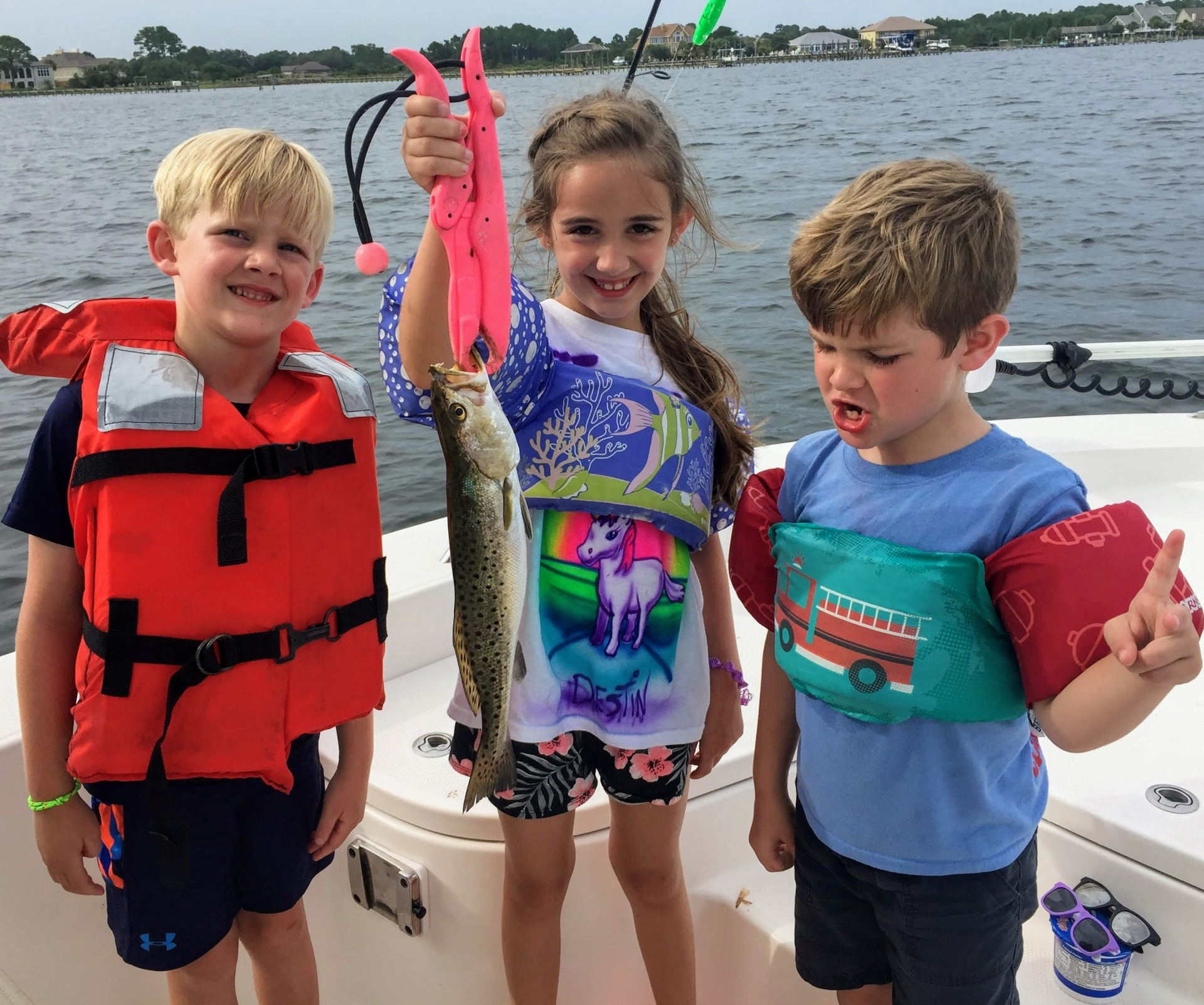 3 kids with a trout